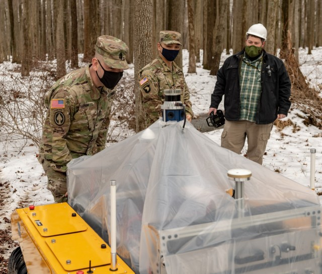 Soldiers and scientists observe autonomous ground vehicle tests at the DEVCOM ARL Research Robotics Collaboration Campus in Graces Quarters, Maryland.