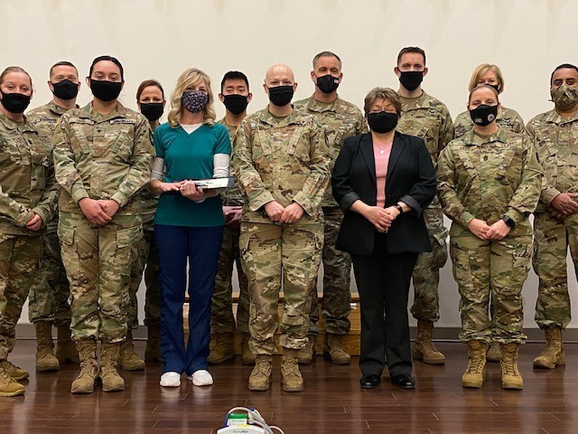 Brig. Gen. James Bienlien (2nd row, center), the Natick Soldier Systems Center senior commander, presented coins to key medical staff during an impromptu ceremony Feb. 24 at Hunter Auditorium. Vicki Juncker (front center) earned an on-the-spot award for her work on the front line of the team. (USAG Natick photo by Vannessa Josey, USAG Natick Public Affairs)