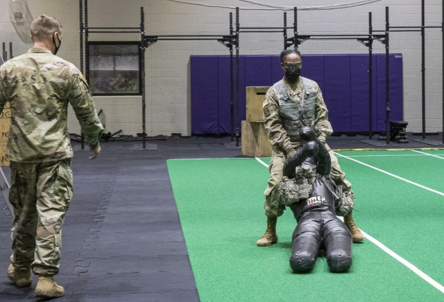 """Soldiers assigned to units at Fort Eustis, Virginia, participate in realistic Army Combat Fitness Test, or ACFT, training to represent battlefield conditions, Feb. 26, 2021. Instead of the traditional 90-pound """"sled"""" used for the """"drag"""" portion of the """"sprint, drag, carry,"""" a 140-pound dummy was used."""