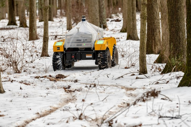 DEVCOM ARL Soldiers and scientists observe an autonomous ground vehicle a series of test conducted at the ARL Research Robotics Collaboration Campus in Graces Quarters, Maryland. The tests marked the first to robotic vehicle autonomously navigated snow-covered terrain.