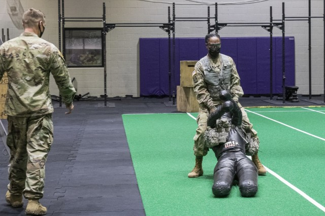 """Soldiers assigned to units at Fort Eustis, Virginia, participate in realistic Army Combat Fitness Test, or ACFT, training to represent battlefield conditions, Feb. 26, 2021. Instead of the traditional 90 pound """"sled"""" used for the """"drag"""" portion of the """"sprint, drag, carry,"""" a 140 pound dummy was used. (U.S. Army photo by David Overson)"""