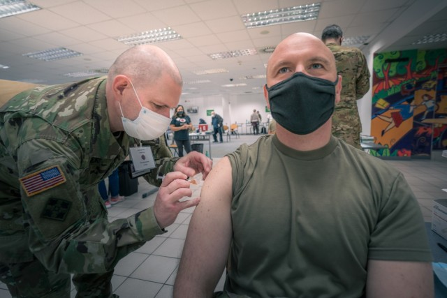 A U.S. Army Soldier from 1st Battalion, 214th Aviation Regiment, 12th Combat Aviation Brigade, receives his second and final COVID vaccine dose on Feb. 24, 2021 in Wiesbaden, Germany. (U.S. Army photo by Maj. Robert Fellingham)