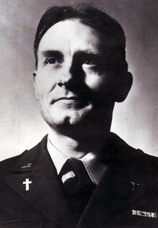 Chaplain (Capt.) Emil J. Kapaun posing for a portrait, the symbol of the cross prominently displayed on his lapels.