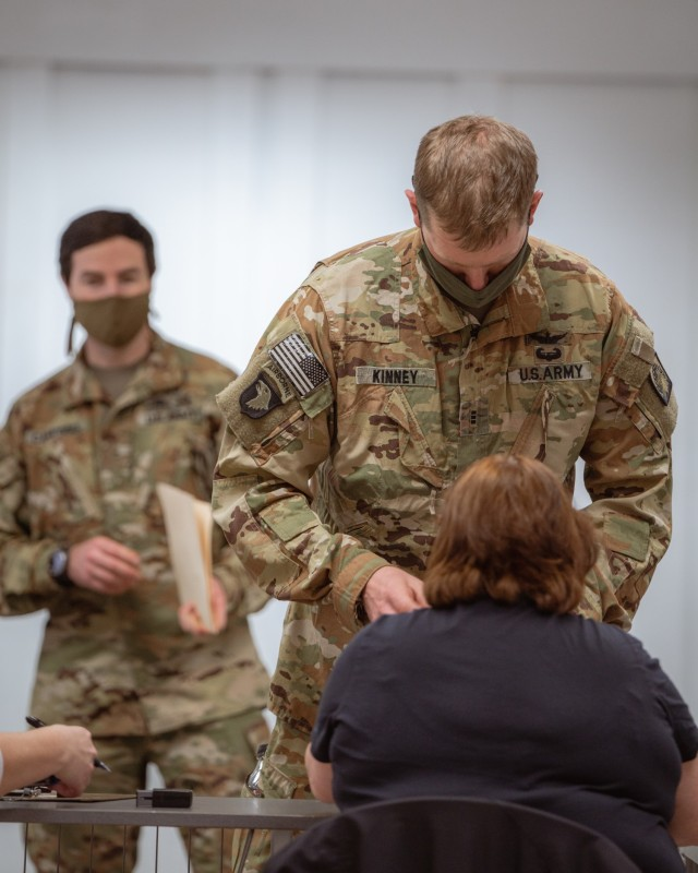 Chief Warrant Officer 3 Kinney, a UH-60 pilot from 1st Battalion, 214th Aviation Regiment, 12th Combat Aviation Brigade, verifies his identity and shot record before receiving the second and final COVID vaccine dose on Feb. 24, 2021, in Wiesbaden, Germany. (U.S. Army photo by Maj. Robert Fellingham)
