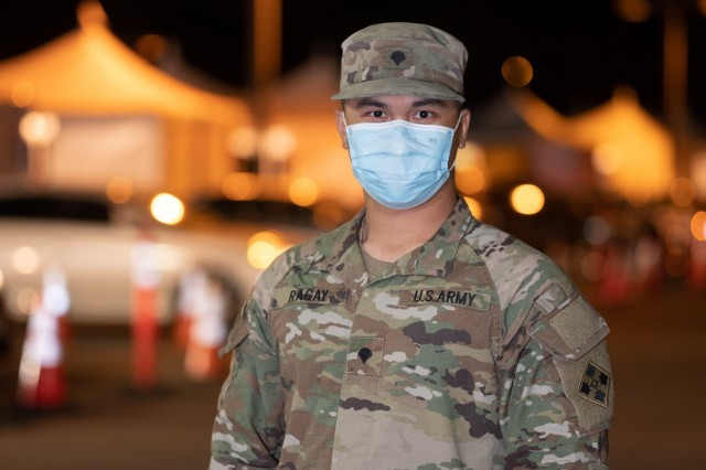 U.S. Army Spc. Brenstein Ragay of Anaheim, California, a combat medic assigned to Charlie Company, 4th Brigade Support Battalion, 1st Stryker Brigade Combat Team, 4th Infantry Division, stands for a photograph after a full day of administering the COVID vaccine at California State University Los Angeles, Feb. 20, 2021. Ragay vaccinated his father, mother and grandmother at the Community Vaccination Center at Cal State LA. U.S. Northern Command, through U.S. Army North, remains committed to providing continued, flexible Department of Defense support to the Federal Emergency Management Agency as part of the whole-of-government response to COVID-19. (U.S. Army photo by Capt. Daniel Parker)