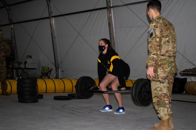 Spc. Lauren Smith and Maj. Daniel Diaz, aviation Soldiers assigned to Regional Command-East, Kosovo Force, teach an Army Combat Fitness Test safety course during an aviation stand down at Camp Bondsteel, Kosovo, on March 6, 2021. The stand down emphasized safety in all areas of Army skills, not just those that are aviation-specific. (U.S. Army National Guard photo by Sgt. Jonathan Perdelwitz)