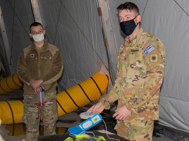Sgt. Tye Thompson, an aviation Soldier assigned to Regional Command-East, Kosovo Force, teaches a class on the use of an automated external defibrillator during an aviation stand down at Camp Bondsteel, Kosovo, on March 6, 2021. Soldiers focused on many aspects of safety during their two-day stand down, including medical response training. (U.S. Army National Guard photo by Sgt. Jonathan Perdelwitz)