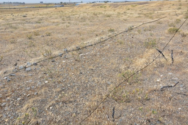 A historic wagon road, dated from 1878, was part of the Oregon Trail that connected the Missouri River with the valleys of Oregon.  A portion of the trail located on Camp Umatilla Oregon was documented using LiDAR and photography. This particular section has been improved with cobbles lining the edges of the trail.