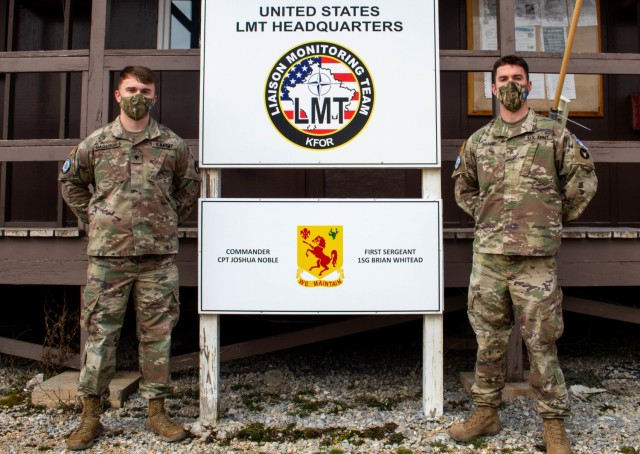 Sgt. Spenser Sharp and Spc. Cole Magnuson, Iowa Army National Guard Soldiers assigned to the Kilo 18 Liaison Monitoring Team, Regional Command-East, Kosovo Force, pose for a photo after a recognition ceremony at Camp Bondsteel, Kosovo, on March 8, 2021. While returning to Camp Bondsteel after a routine mission, the Sioux City, Iowa, natives saw a car burning in a parking lot. The two pulled over to aid civilians in moving the vehicle next to it to prevent further damage. (U.S. Army National Guard photo by Sgt. Jonathan Perdelwitz)