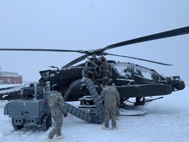 Logistics Assistance Representatives from Aviation & Missile Command (AMCOM) support 1-25 Attack Reconnaissance Battalion with arctic testing of AH-64 Apache in order to identify equipment capabilities for operating in arctic conditions.