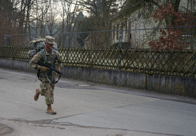 Pfc. Samuil Matveev, USAG Rheinland Pfalz, runs to the finish during the 10.6 mile ruck march at Oberdachstetten Training Area March 3 as the final event of the Installation Management Command-Europe Best Warrior Competition running from Feb. 28 to Mar. 3. Matveev finished with a time of 2 hours 54 minutes. The competition enhances expertise, training, and understanding of the skills needed to be a well-rounded Soldier. Winners will go on to compete at the Installation Management Command level in San Antonio, Texas.