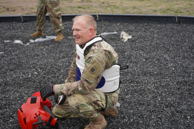 Chief Warrant Officer two Downer takes a breather before competing in the final round of the Pugile Stick fight on day three of the competition.
