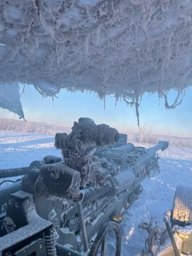Logistics Assistance Representatives from Tank, Automotive & Armament Command (TACOM) assist 2-377 Parachute Field Artillery Regiment (PFAR) with troubleshooting and repair of M777 Howitzer impacted by arctic conditions below -20F.