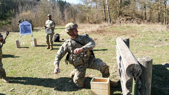 """Sgt. David Baker, USAG Ansbach, takes aim and throws his grenade at Oberdachstetten Training Area March 2 at the 2021 """"Best Warrior Competition"""". The competition enhances expertise, training, and understanding of the skills needed to be a well-rounded Soldier. Winners will go on to compete at the Installation Management Command level in San Antonio, Texas."""