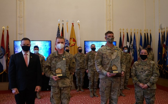 From Right: Sgt. David Baker, USAG Ansbach, and Pfc. Samuil Matveev, USAG Rheinland Pfalz, win the NCO and Soldier categories at the Installation Management Command-Europe Best Warrior Competition Mar. 3. They were presented the awards by Regional Director Tommy Mize and Command Sgt. Maj. Samara Pitre. The competition runs from Feb. 28 to Mar. 3. The competition enhances expertise, training, and understanding of the skills needed to be a well-rounded Soldier. Winners will go on to compete at the Installation Management Command level in San Antonio, Texas.