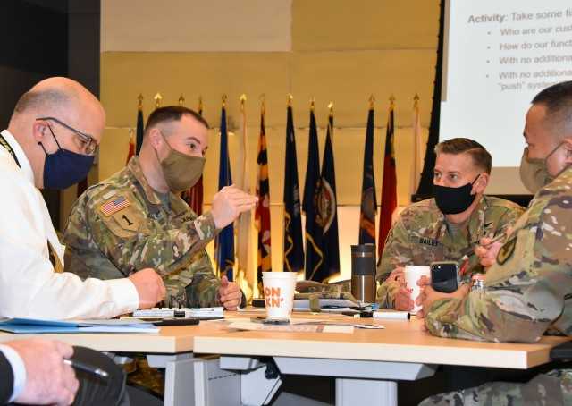 Lt. Col. Dan O'Neill, second from left, deputy commander of the U.S. Army Medical Materiel Agency, talks with USAMMA leaders during an Army Medical Logistics Command workshop on March 4 at Fort Detrick, Maryland. USAMMA is one of three direct reporting units to AMLC.