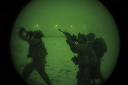 U.S. Army Soldiers assigned to 1st Battalion, 4th Infantry Regiment, cover the high ground, as seen through a Night Optical Device at Hohenfels Training Area, Germany, Feb. 16, 2021.