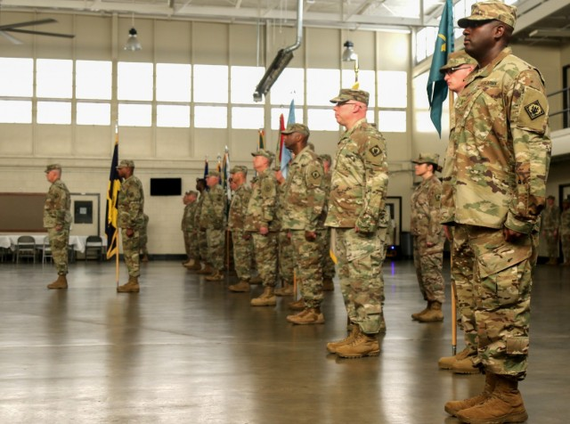 Soldiers assigned to 66th Troop Command stand at attention during a promotion and change of command ceremony at the Raymond Road Readiness Center in Jackson, Miss., June 2, 2018. As the Army continues efforts to improve diversity within its ranks, it is also reinforcing policies to eradicate extremist behaviors and activities. The battle against extremism is different from other challenges the Army encounters, said Col. Timothy Holman, the Army's chief diversity officer. Extremism can tear apart cohesive teams.
