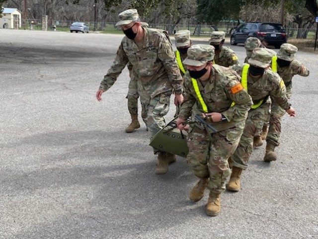 Advanced Individual Training (AIT) Soldiers assigned to the U.S. Army Medical Center of Excellence (MEDCoE) demonstrate use of the sked and litter carries during patient evacuation during Transition Training (SiTT) February 2021 at Joint Base San Antonio-Fort Sam Houston, Texas.