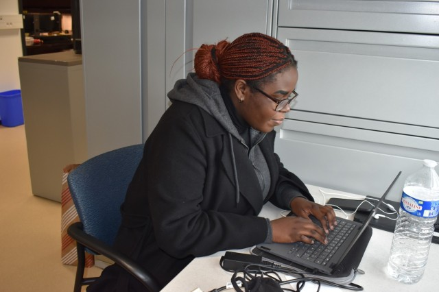 CHIÈVRES, Belgium – Maryse Wetuyizila-Miezi, an intern from the University of Mons, works at her desk at the Religious Support Office Feb. 21. Since February, local Belgian college students have been helping U.S. Army Garrison Benelux at Chièvres Air Base accomplish its mission by participating in the garrison's internship program. USAG Benelux has offered internships to students from the Faculty of Translation and Interpretation of the University of Mons, which gives them an immersive linguistic and cultural experience with English native speakers, all without leaving the country. (U.S. Army photo by Stephanie Delcroix, U.S. Army Garrison Benelux Public Affairs)