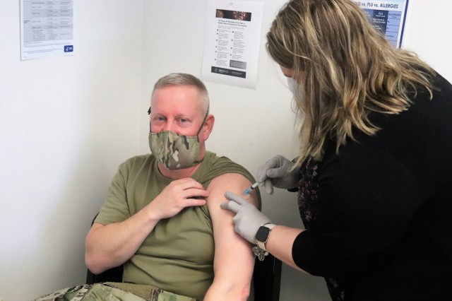 Command Sgt. Maj. Paul Mantha, garrison command sergeant major, receives a second COVID-19 vaccination Feb. 26, 2021, at the Occupational Health Clinic at Fort McCoy, Wis. The clinic began providing COVID-19 shots in January 2021 and have continued the effort under a strict set of procedures that began with giving vaccinations to frontline and emergency services personnel. (U.S. Army Photo by Scott T. Sturkol, Public Affairs Office, Fort McCoy, Wis.)