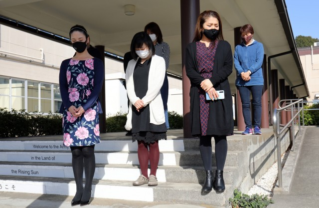 U.S. Army Garrison Japan employees stand outside the headquarters building at Camp Zama, Japan, at 2:46 p.m. March 11, in commemoration of the magnitude 9.0 earthquake that struck off the eastern coast of Japan 10 years ago.
