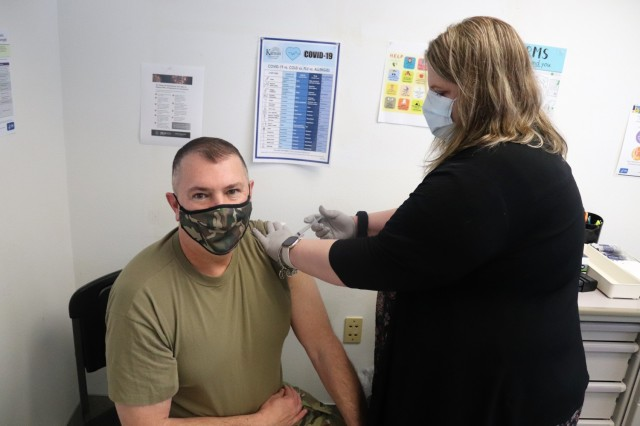 Garrison Commander Col. Michael Poss receives a second COVID-19 vaccination Feb. 26, 2021, at the Occupational Health Clinic at Fort McCoy, Wis. The clinic began providing COVID-19 shots in January 2021 and have continued the effort under a strict set of procedures that began with giving vaccinations to frontline and emergency services personnel. Poss was the first Soldier to receive the vaccine at the installation. (U.S. Army Photo by Scott T. Sturkol, Public Affairs Office, Fort McCoy, Wis.)