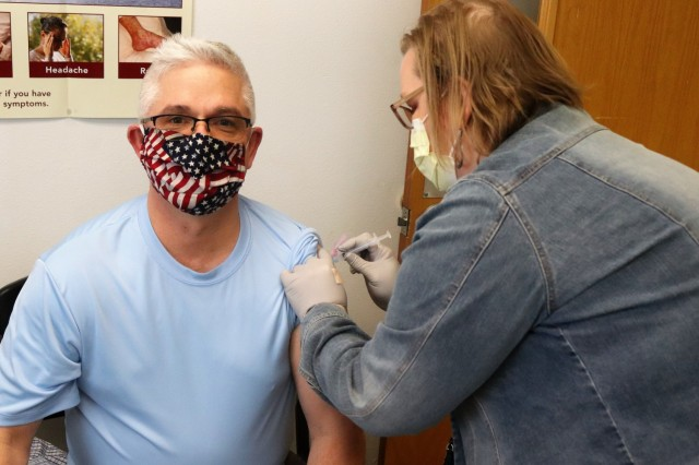 Deputy to the Garrison Commander Brad Stewart receives a second COVID-19 vaccination Feb. 26, 2021, at the Occupational Health Clinic at Fort McCoy, Wis. The clinic began providing COVID-19 shots in January 2021 and have continued the effort under a strict set of procedures that began with giving vaccinations to frontline and emergency services personnel. (U.S. Army Photo by Scott T. Sturkol, Public Affairs Office, Fort McCoy, Wis.)