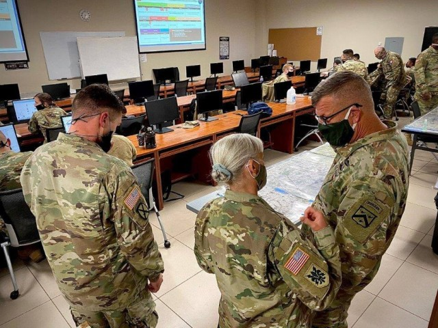 Then-Maj. Gen. Laura Potter, commander of the U.S. Army Intelligence Center of Excellence, briefs Lt. Gen. James E. Rainey at Fort Huachuca, Ariz. Potter, now a lieutenant general and deputy chief of staff, G-2, discussed Army intelligence's challenges and priorities during an Association of the U.S. Army Noon Report on March 10, 2021.