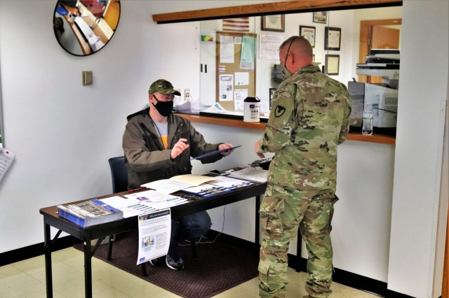 A Soldier prepares to sign in to receive the COVID-19 vaccine Feb. 26, 2021, at the Occupational Health Clinic at Fort McCoy, Wis. The clinic began providing COVID-19 shots in January 2021 and have continued the effort under a strict set of procedures that began with giving vaccinations to frontline and emergency services personnel. (U.S. Army Photo by Scott T. Sturkol, Public Affairs Office, Fort McCoy, Wis.)