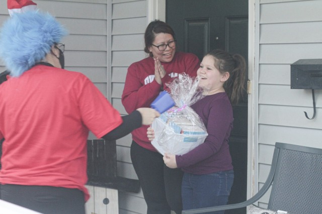 Kynlee Barber shouts with joy March 5 when her mom, Ashlee Beasley, opens the door for the Cat in the Hat and Thing 1. Barber is a third grade student at Andre Lucas Elementary School.