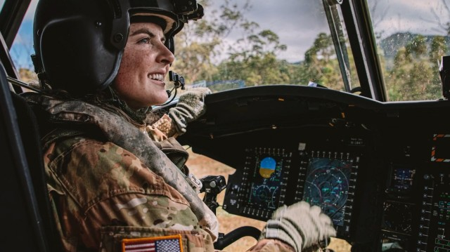 First Lt. Olivia Lopes, a pilot assigned to 3rd Battalion, 25th Aviation Regiment, 25th Combat Aviation Brigade, 25th Infantry Division, flies Soldiers in a CH-47 Chinook during training May 20, 2020, at Schofield Barracks, Hawaii.