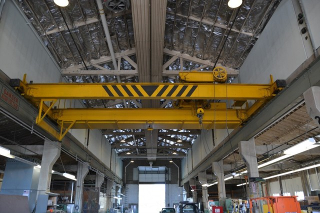 The enormous gantry crane within Building 4, the Machine Shop, is still perched upon its rails.  While no longer in use, the crane will be preserved to convey the design, feeling and association of the industrial repair work once done at Camp Umatilla, Oregon.