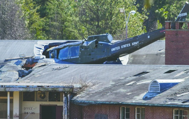 A Huey is lodged in the roof at the Lorton Training Site, which is one of many items at the Fairfax County Urban Search and Rescue location.