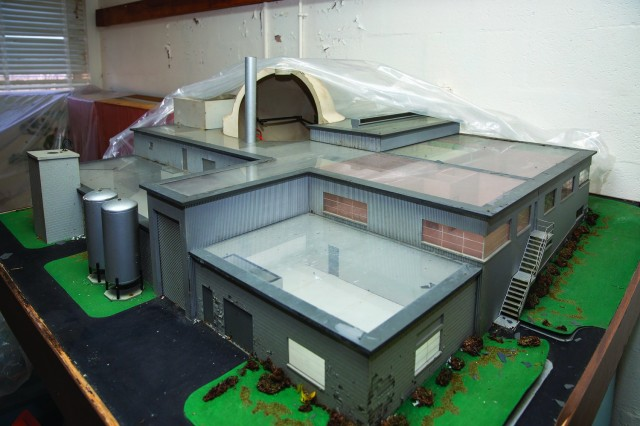 a scale model of the Fort Belvoir SM-1 nuclear power plant, sitting in under plastic in the reception area in this January photo.