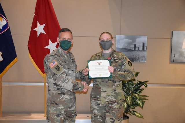 Sergeant 1st Class Abigail Keller, an operations noncommissioned-officer-in-charge with 1st Space Company, 1st Space Battalion, receives the Bronze Star from Lt. Gen. Daniel L. Karbler, commander, U.S. Space and Missile Defense Command, for her exceptionally meritorious service in combat zone with exposure to risk to hostile action in support of Combined Joint Task Force - Inherent Resolve, 2019-2020, at Peterson Air Force Base, Colo., Mar. 12. (Photo by Dottie K. White/RELEASED)