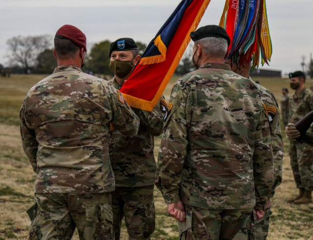 Major General JP McGee, incoming commanding general, 101st Airborne Division (Air Assault) and Fort Campbell, receives the division colors from Lt. Gen. Michael E. Kurilla, commanding general, XVIII Airborne Corps, and Maj. Gen. Brian E. Winski, outgoing commanding general, 101st Abn. Div. and Fort Campbell, March 5 during the division change of command at the division parade field.