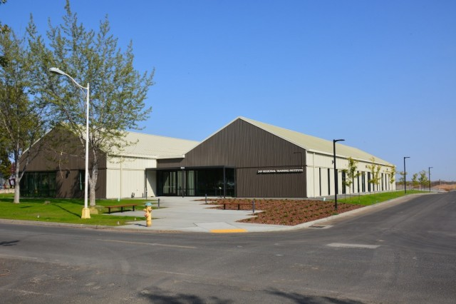 The recently completed Regional Training Institute Classroom building provides the needed classroom space for Soldiers training at Camp Umatilla, Oregon. The RTI building is situated adjacent to the administrative portion of historic district and can be seen from within the district.  Modern architectural styling clearly states the building is not included in the historic district, but muted, earth tones allow the RTI building to subtlety stand apart without being overbearing.