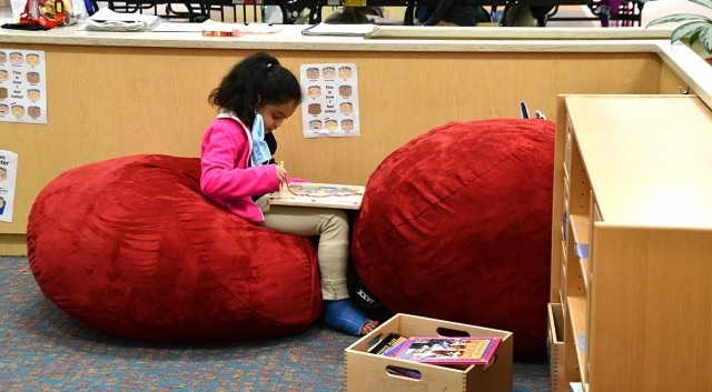 Emily Rodriguez spends some quiet time alone at the School Age Center's After School Program March 9.