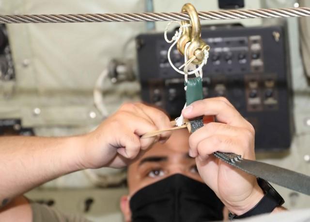 Soldiers, Marines airdrop medical supplies, food