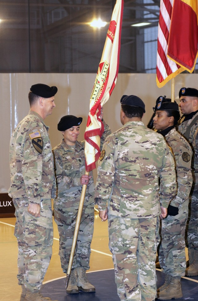 Command Sgt. Maj. Samara Pitre accepts the U.S. Army Garrison Benelux flag signaling her assumption of responsibility as the senior enlisted advisor to the garrison on Oct. 24, 2017, at Chièvres Air Base, Belgium.