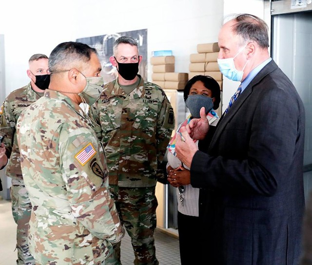 Gen. Michael X. Garrett, commanding general of United States Army Forces Command (left), Brig. Gen. David S. Doyle, Joint Readiness Training Center and Fort Polk commanding general (middle), Col. Ryan K. Roseberry Fort Polk garrison commander (far left) and Parkway Elementary School Principal Dione Bradford listen as James Williams, Vernon Parish School Superintendent, talks about educational initiatives in Vernon Parish