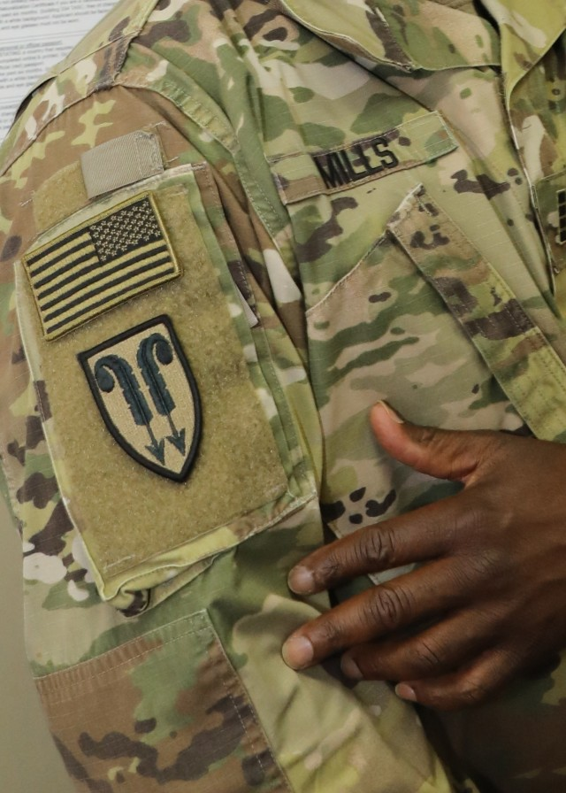 Army Reserve Chief Warrant Officer 4 Denrick Mills, 310th Sustainment Command (Expeditionary) now deployed to Camp Arifjan, Kuwait, March 1, 2021, shows off his 22nd Support Command (Provisional) combat patch, which he wears as a tribute to his service in the First Gulf War 30 years ago. Mills said during the war, he was put in charge of all Army air cargo and air passengers coming through Riyadh as a specialist.