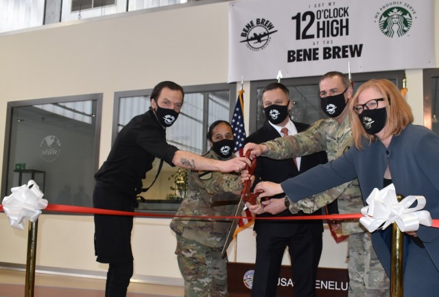 CHIÈVRES, Belgium – From left, David Frère, barista at the newly opened Bene Brew Café and Pub; U.S. Army Garrison Benelux Command Sgt. Maj. Katrina Herzfeld; Tommy Mize, director of Installation Management Command Directorate – Europe; Col. James Yastrzemsky, USAG Benelux commander; and Stacy Perez, director of Family and Morale, Welfare and Recreation, officially cut the ribbon to the Bene Brew. The Bene Brew Café and Pub officially opened its doors March 11 at Chièvres Air Base, Belgium in a ribbon-cutting ceremony with Mize. (U.S. Army photo by Christophe Morel, USAG Benelux Public Affairs)
