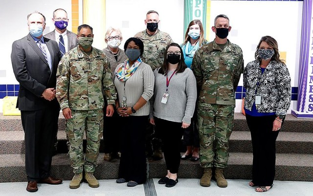 James Williams, Vernon Parish School Superintendent, Mike Kay, Vernon Parish Assistant Superintendent, Gen. Michael X. Garrett, commanding general of United States Army Forces Command, Anne Smith, Parish School Board Elementary curriculum director, Dione Bradford, Parkway Elementary School Principal, Col. Ryan K. Roseberry Fort Polk garrison commander,  Samantha Westerfield, Vernon Parish Elementary School Teacher of the Year, Tiffany Koch, Fort Polk School Liaison Officer, Brig. Gen. David S. Doyle, Joint Readiness Training Center and Fort Polk commanding general, and Ian McDonald, Parkway Assistant Principal, pose for a picture during the tour of Parkway Elementary.
