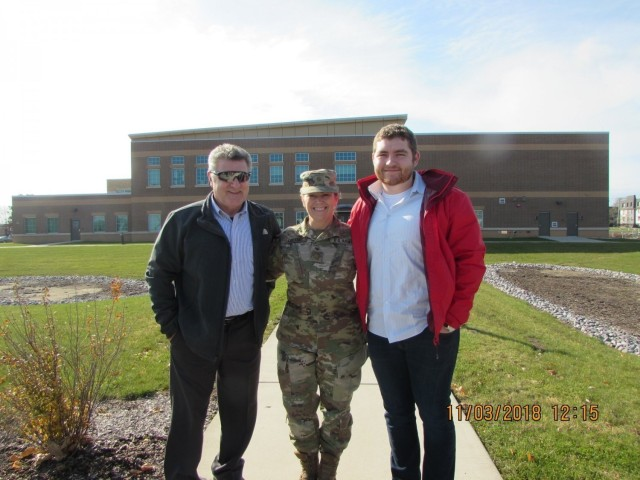 Maj. Catherine A. Celeski with her husband Gregory (left) and son Justin in 2018.  Celeski, an Army Reserve critical care nurse from San Antonio, Texas, mobilized in mid-December 2020 with Army Reserve Urban Augmentation Medical Task Force 328-1 to assist the Yuma Regional Medical Center in Yuma, Arizona. Urban Augmentation Medical Task Forces are examples of U.S. Northern Command's commitment, through U.S. Army North, to providing flexible Department of Defense support for the whole-of-government COVID-19 response.