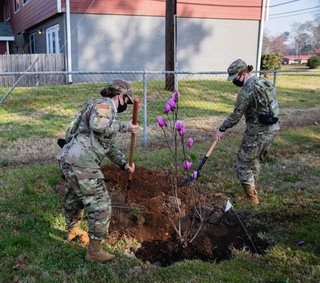 Planting a tree at Fort Benning.
