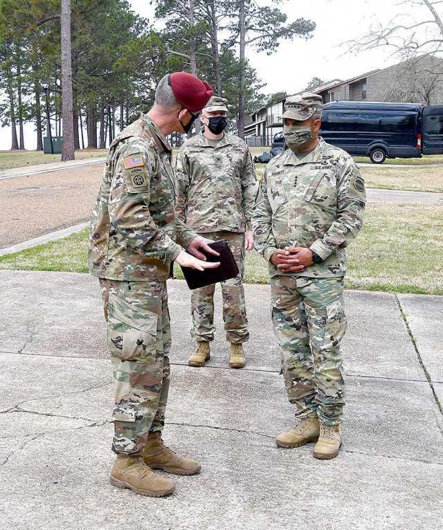 Garrett  receives a briefing on housing repairs from Brig. Gen. David Doyle, commanding general, Joint Readiness Training Center and Fort Polk, during his visit.