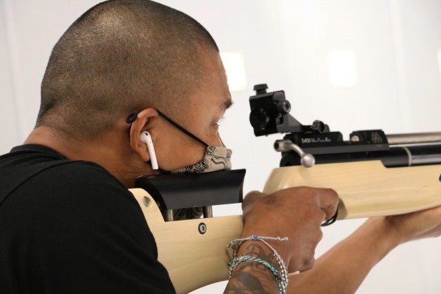 U.S. Army Staff Sgt. Gene Calantoc, Soldier Recovery Unit, Brooke Army Medical Center, takes careful aim during the Virtual Army Trials air rifle event at Cole High School, Fort Sam Houston, Texas, March 4, 2021. Calantoc and several other BAMC SRU Soldiers are vying for selection to Team Army to compete in the DoD Warrior Games in September.  (U.S. Army photo by Robert A. Whetstone)