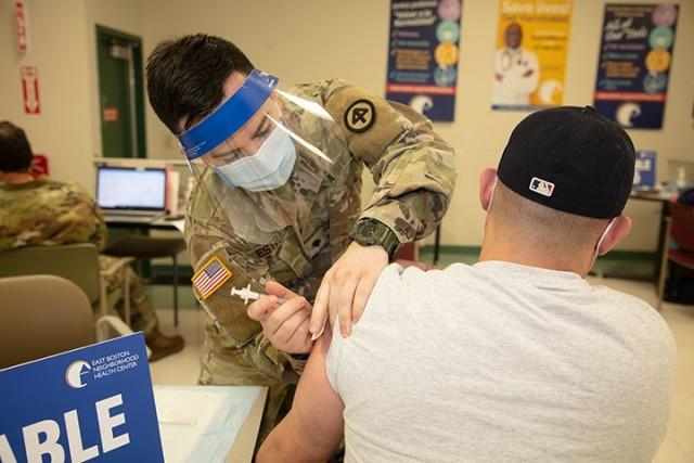 Massachusetts Guard's Kilo Team administers COVID vaccine